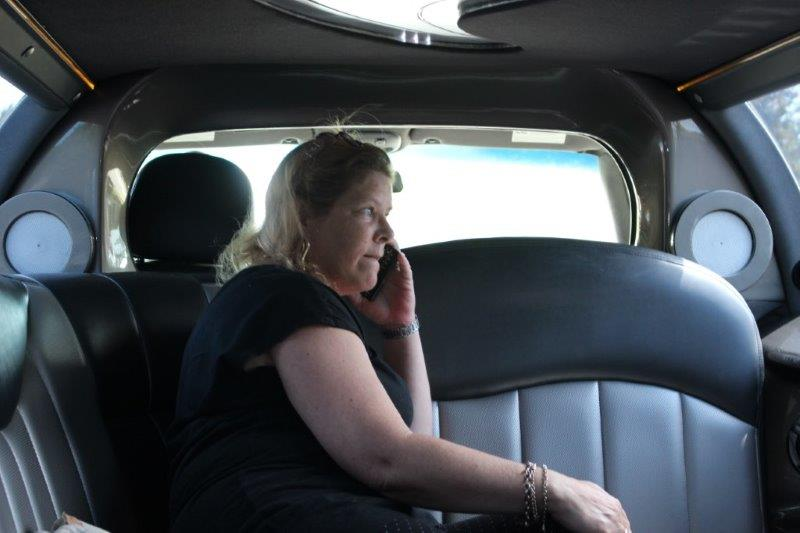 Debi on the phone, working in the limo