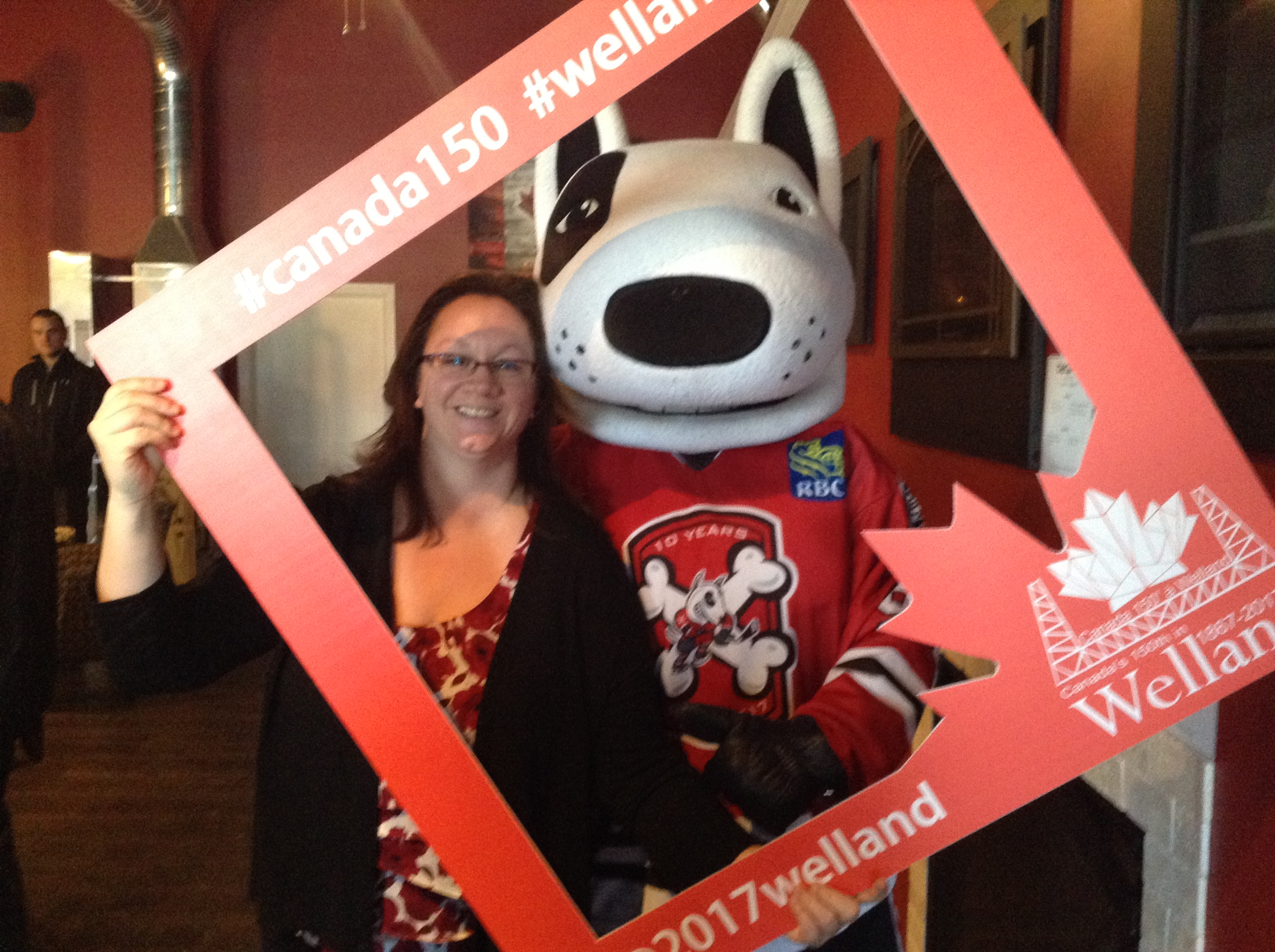 Jennifer Konderka with Niagara Ice Dogs faithful companion Bones