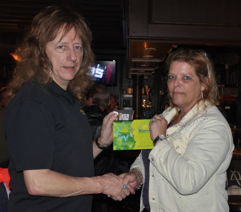 Andy Harris receiving his gift card prize