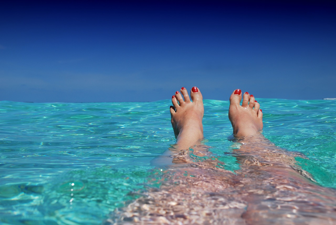 feet in water at beach